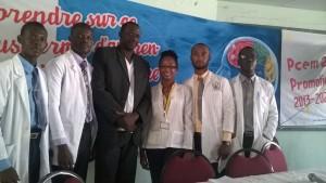 Des membres du comité et le Dr Eliode Pierre